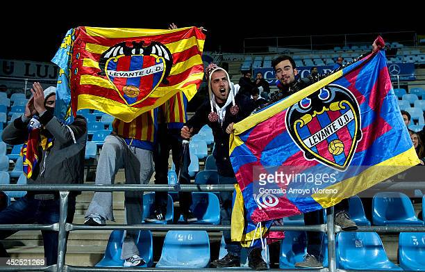 Levante UD fan and his friends cheer their team during the La Liga match between Getafe CF and Levante UD at Coliseum Alfonso Perez on November 29...