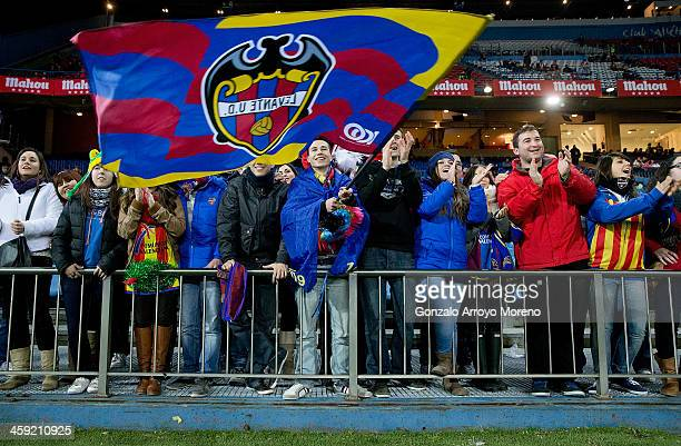 Levante UD fans cheer their team prior to start the La Liga match between Club Atletico de Madrid and Levante UD at Vicente Calderon Stadium on...
