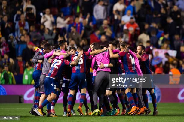 Levante UD players celebrate victory after the La Liga match between Levante UD and FC Barcelona at Estadi Ciutat de Valencia on May 13 2018 in...