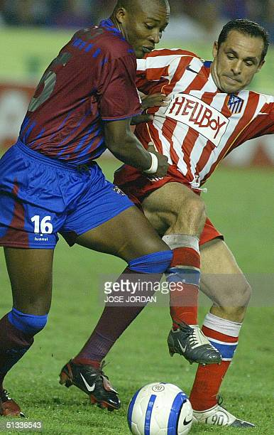 Levante's Colombian Edwin Congo fights for the ball with Atletico Madrid's Sergi Barjuan during a league soccer match in Ciudad de Valencia Stadium...