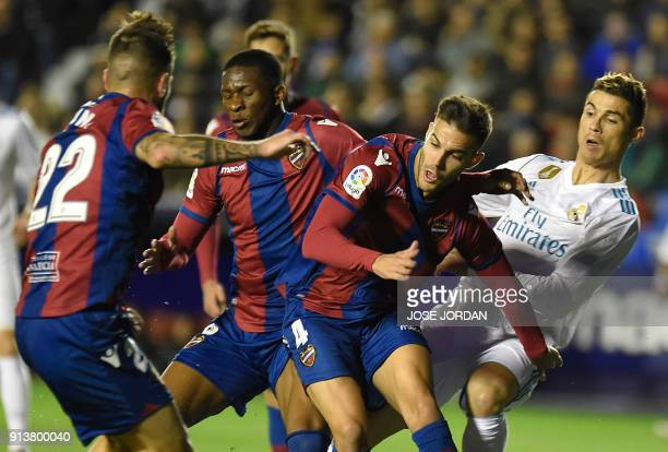 Levante's defender Antonio Luna Levante's defender Rober Pier Levante's Colombian midfielder Jefferson Lerma Real Madrid's Portuguese forward...