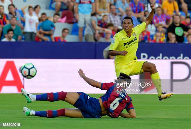 Levante's defender Chema Rodriguez vies with Villarreal's Colombian forward Carlos Bacca during the Spanish league footbal match Levante UD vs...