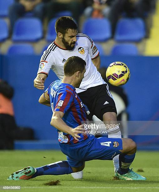 Levante's defender David Navarro vies with Valencia's forward Alvaro Negredo during the Spanish league football match Levante UD vs Valencia CF at...