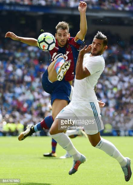 Levante's defender Ivan Lopez vies with Real Madrid's French defender Theo Hernandez during the Spanish Liga football match Real Madrid vs Levante at...