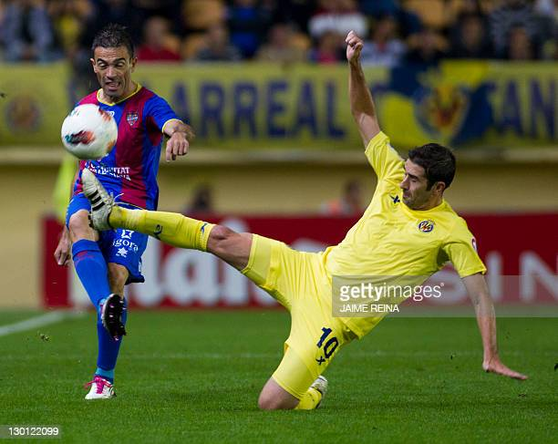 Levante's defender Javier Rodriguez Venta vies for the ball with Villarreal's midfielder Cani during the Spanish league football match between...