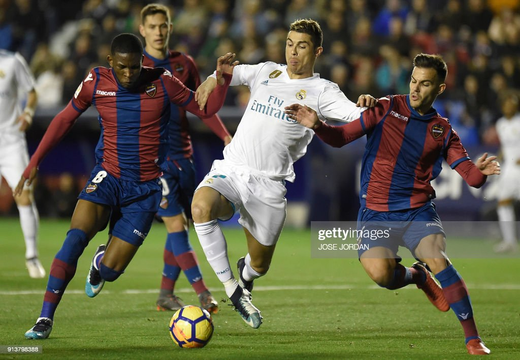 Levante's defender Rober Pier and Levante's Colombian midfielder Jefferson Lerma (L) vie with Real Madrid's Portuguese forward Cristiano Ronaldo during the Spanish league football match between Levante UD and Real Madrid CF at the Ciutat de Valencia stadium in Valencia on February 03, 2018. /