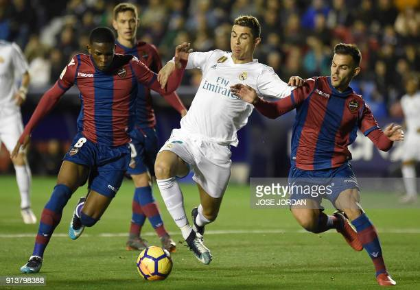 Levante's defender Rober Pier and Levante's Colombian midfielder Jefferson Lerma vie with Real Madrid's Portuguese forward Cristiano Ronaldo during...
