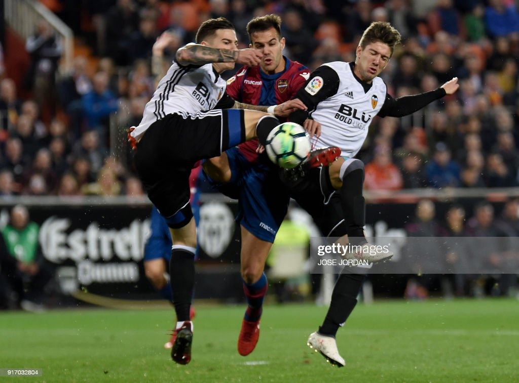 Levante's defender Rober Pier (C) vies with Valencia's forward Santi Mina and Valencia's Argentinian forward Luciano Vietto (R) during the Spanish league football match between Valencia CF and Levante UD at the Mestalla stadium in Valencia on February 11, 2018. /