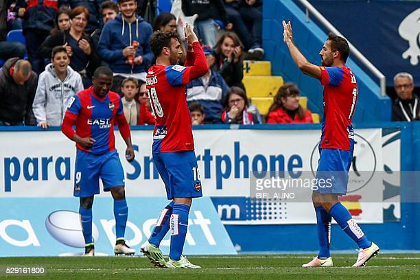 Levante's forward Victor Casadesus celebrates with his teammates after scoring during the Spanish league football match Levante UD vs Club Atletico...