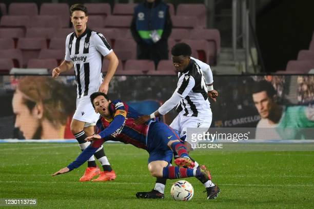 Levante's French midfielder Mickael Malsa challenges Barcelona's Argentinian forward Lionel Messi during the Spanish league football match between FC...