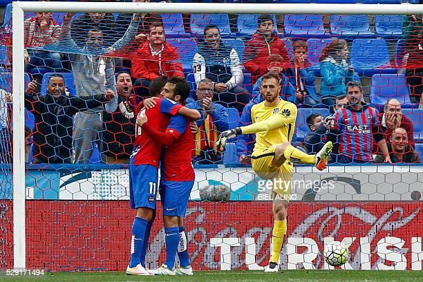 Levantes Italian forward Giuseppe Rossi celebrates with his teammate Levante's midfielder Jose Luis Morales after scoring as Atletico Madrid's...