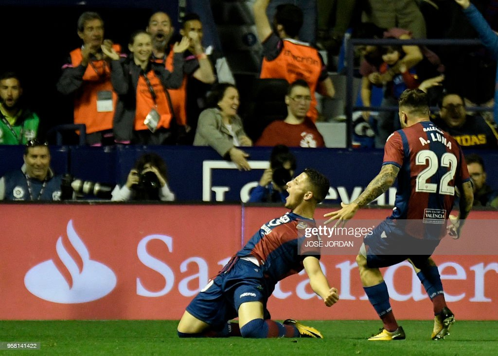 Levante's Macedonian midfielder Enis Bardhi (L) celebrates after scoring a goal during the Spanish league football match between Levante and Barcelona at the Ciutat de Valencia stadium in Valencia on May 13, 2018.