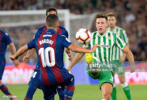 Levante's Macedonian midfielder Enis Bardhi fights for the ball with Real Betis' Spanish forward Francis Guerrero during the Spanish league football...