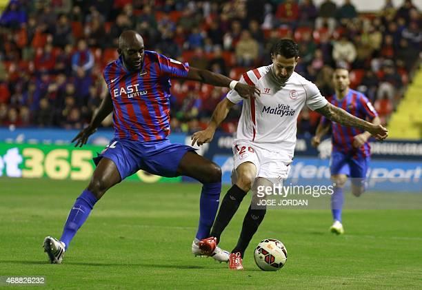 Levante's Malian midfielder Mohamed Lamine Sissoko vies with Sevilla's midfielder Vitolo during the Spanish league football match Levante UD vs...