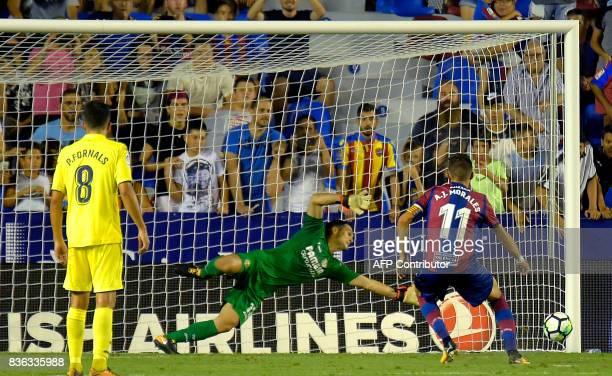 Levante's midfielder Jose Luis Morales scores during the Spanish league footbal match Levante UD vs Villarreal CF at the Ciutat de Valencia stadium...