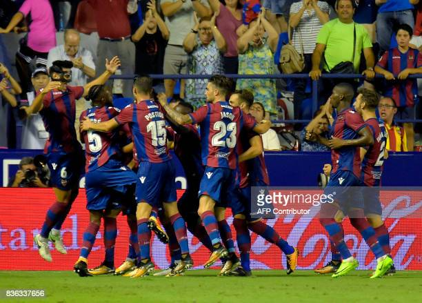 Levante's players celebrate after midfielder Jose Luis Morales scored during the Spanish league footbal match Levante UD vs Villarreal CF at the...