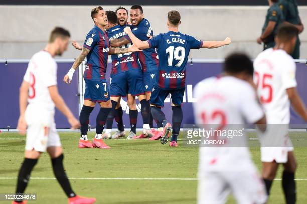 Levante's players celebrate Sevilla's own goal during the Spanish League football match between Levante UD and Sevilla FC at the Ciutat de Valencia...