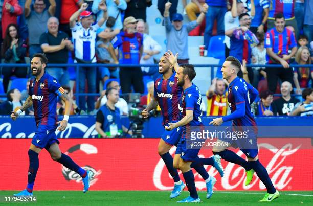 Levante's players celebrate their third goal scored by Levante's Serbian defender Nemanja Radoja during the Spanish League football match between...