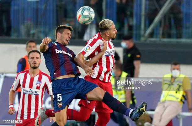 Levante's Serbian defender Nemanja Radoja vies with Atletico Madrid's Mexican midfielder Hector Herrera during the Spanish league football match...