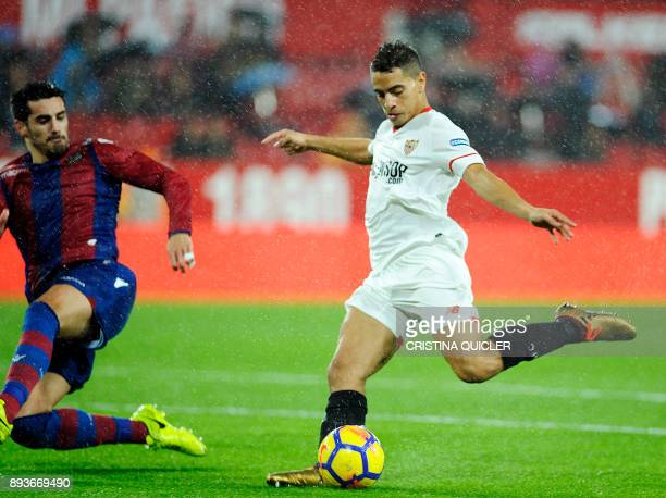 TOPSHOT Levante's Spanish defender Chema Rodriguez vies with Sevilla's French forward Wissam Ben Yedder during the Spanish league football match...
