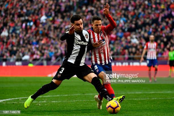 Levante's Spanish defender Tono Garcia vies for the ball with Atletico Madrid's Colombian defender Santiago Arias during the Spanish League football...