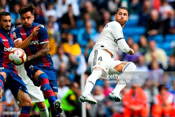 Levante's Spanish defender Tono Garcia vies with Real Madrid's Spanish defender Sergio Ramos during the Spanish league football match Real Madrid CF...