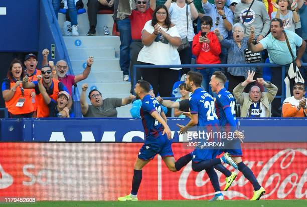 Levante's Spanish forward Borja Mayoral celebrates his team's second goal during the Spanish League football match between Levante UD and FC...