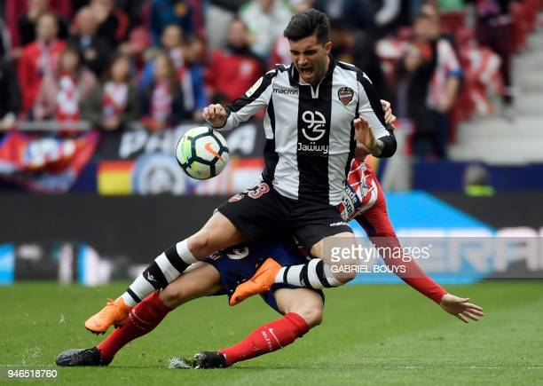 Levante's Spanish forward Jason Remeseiro vies with Atletico Madrid's French defender Lucas Hernandez during the Spanish league football match...