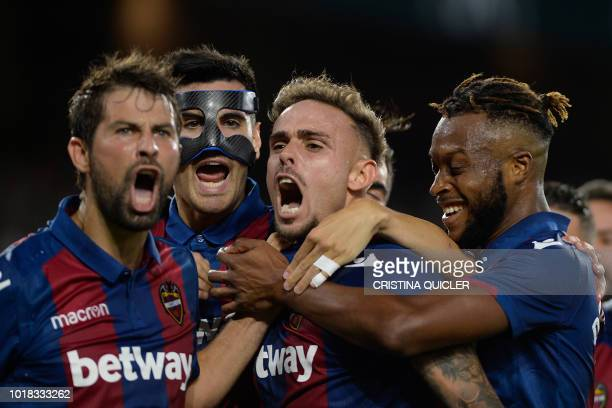 Levante's Spanish forward Roger Marti and his teammates react after scoring a goal during the Spanish league football match between Real Betis and...