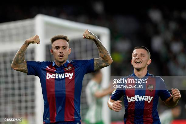 Levante's Spanish forward Roger Marti reacts after scoring a goal during the Spanish league football match between Real Betis and Levante at the...
