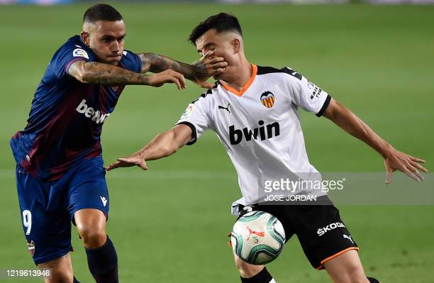 Levante's Spanish forward Roger Marti vies with Valencia's Spanish defender Hugo Guillamon during the Spanish League football match between Valencia...