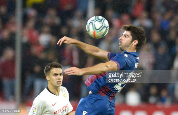 Levante's Spanish midfielder Gonzalo Melero jumps for the ball during the Spanish league football match Sevilla FC vs Levante UD at the Ramon Sanchez...