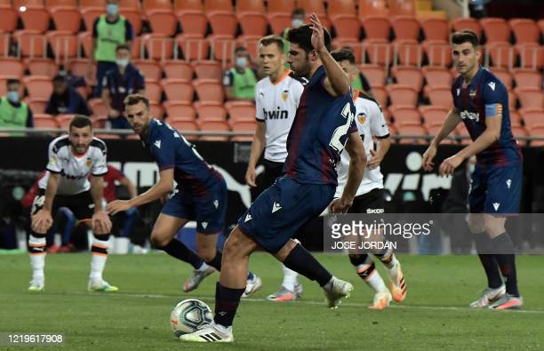 Levante's Spanish midfielder Gonzalo Melero shoots a penalty kick to score a goal during the Spanish League football match between Valencia and...