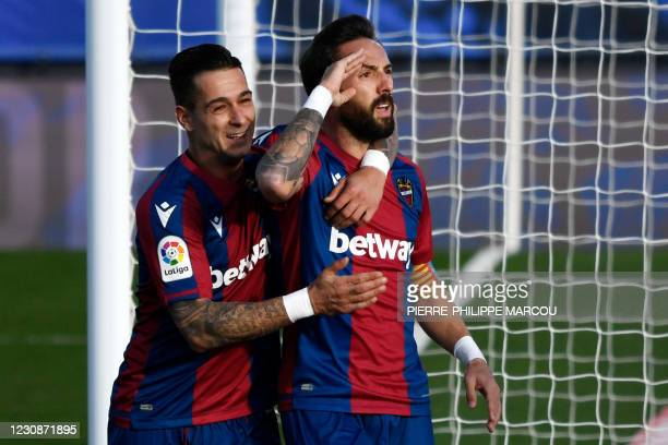 Levante's Spanish midfielder Jose Luis Morales celebrates after scoring a goal during the Spanish league football match Real Madrid CF against...