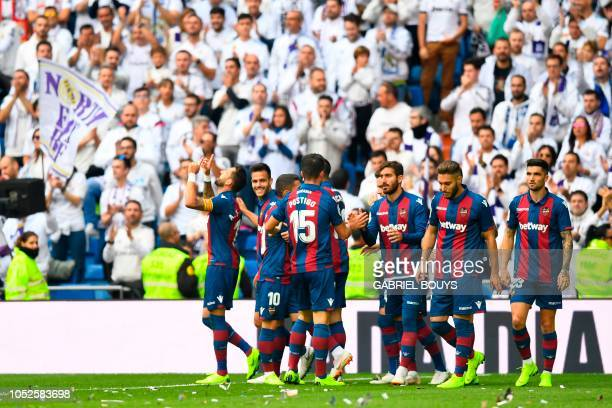 Levante's Spanish midfielder Jose Luis Morales celebrates after scoring during the Spanish league football match Real Madrid CF against Levante UD at...