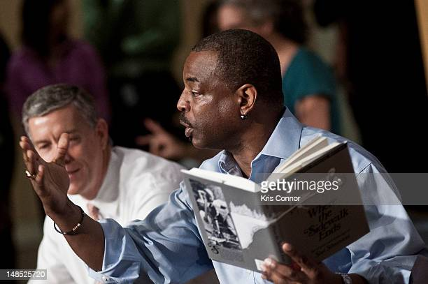 LeVar Burton reads beside Education Minister Arne Duncan during the Let's Read Let's Move summer reading event series at the Education Department on...
