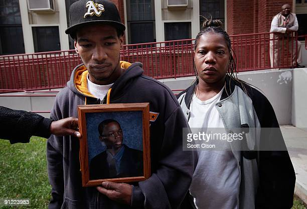 Levar Johnson with his mother Ava Greyer pleads his brother's innocence near a memorial to 16yearold Fenger High School honor roll student Derrion...