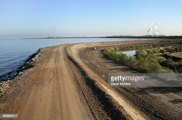 A levee keeps a flood of salt water from ruining agricultural lands on the east shore of the Salton Sea on October 22 2005 across the lake from...