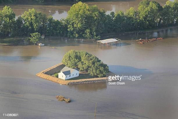 A levee protects a home surrounded by floodwater from the Yazoo River May 18 2011 near Vicksburg Mississippi The flooded Mississippi River is forcing...