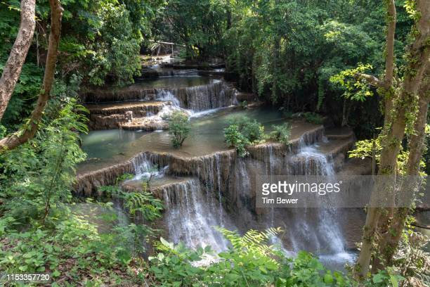 level 4 of huay mae khamin waterfall. - tim bewer stock pictures, royalty-free photos & images