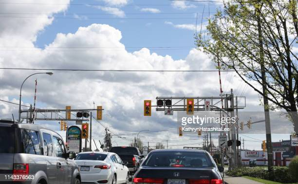 level crossing on 200 street, langley, canada - railroad crossing stock pictures, royalty-free photos & images