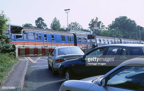 Level crossing traffic queue at Brockenhurst in New Forest Hampshire 2000