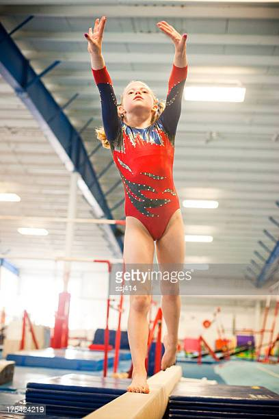 level five gymnast practicing on beam. - little girls leotards stock photos and pictures
