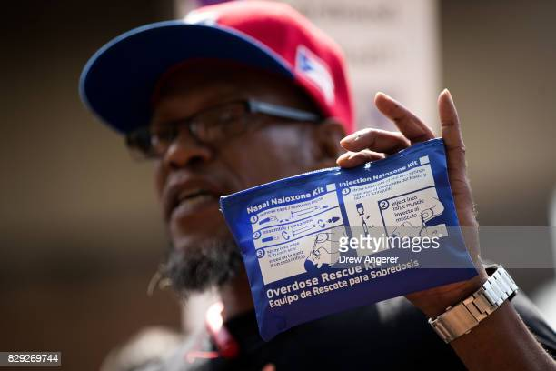 Levele Pointer from the group Vocal New York holds up a naloxone overdose kit while speaking during a protest denouncing the city's 'inadequate and...