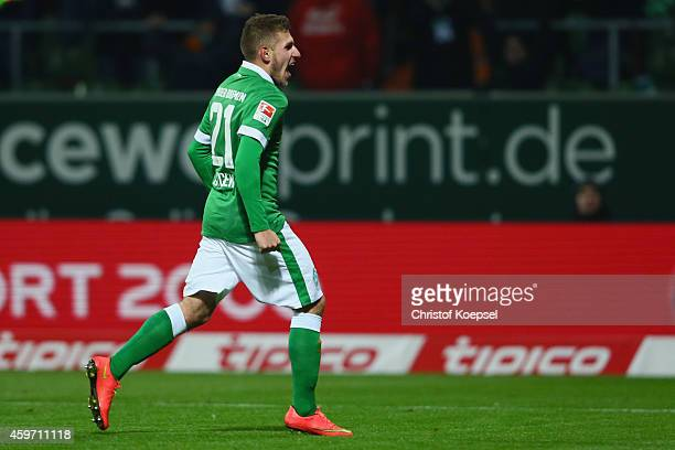Levent Aycicek of Bremen celebrates the forth goal during the Bundesliga match between Werder Bremen and SC Paderborn at Weserstadion on November 29...