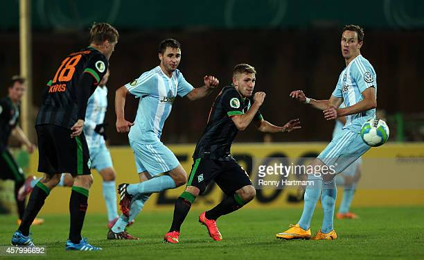 Levent Aycicek of Bremen vies with Kevin Conrad and Tim Danneberg of Chemnitz during the DFB Cup second round match between Chemnitzer FC and Werder...