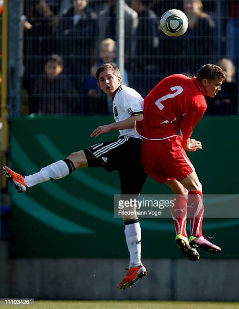 Levent Aycicek of Germany and Joel Untersee of Switzerland battle for the ball during the UEFA U17 European Championship Elite Round match between...