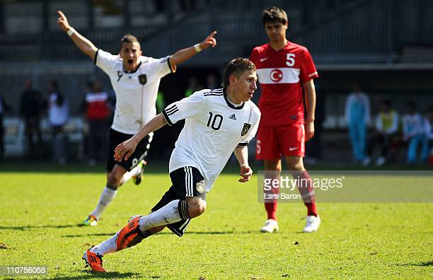 Levent Aycicek of Germany celebrates with team mates after scoring his teams second goal during the UEFA U17 European Championship Elite Round match...