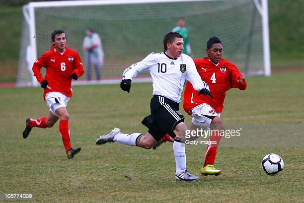 Levent Aycicek of Germany fights for the ball with Philipp Mwene and Sandro Djuric of Austria during the U17 Euro Qualifier match between Austria and...