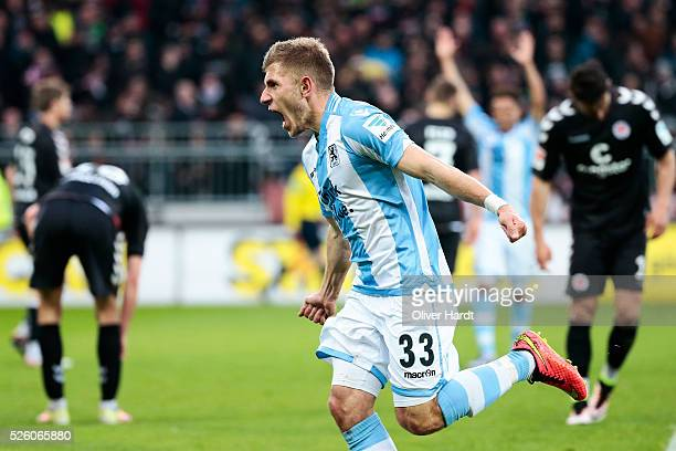 Levent Aycicek of Muenchen celebrates after scoring their first goal during the Second Bundesliga match between FC St Pauli and 1860 Muenchen at...